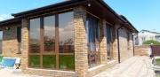 Остекление террасы в частном доме пластиковыми окнами Rehau